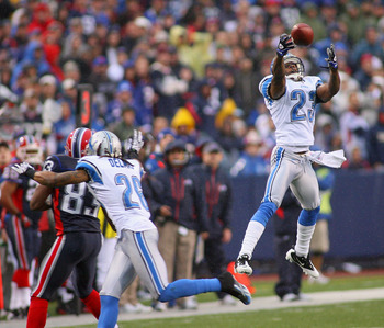 ORCHARD PARK, NY - NOVEMBER 14: Chris Houston #23 of the Detroit Lions unsuccesfully tries to intercept a pass intended for Lee Evans #83 of the Buffalo Bills  at Ralph Wilson Stadium on November 14, 2010 in Orchard Park, New York. Buffalo won 14-12. (Pho