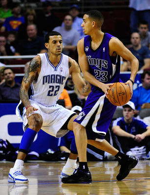 ORLANDO, FL - JANUARY 22:  Kevin Martin #23 of the Sacramento Kings is guarded by Matt Barnes #22 of the Orlando Magic during the game at Amway Arena on January 22, 2010 in Orlando, Florida. NOTE TO USER: User expressly acknowledges and agrees that, by do