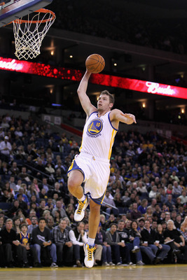 OAKLAND, CA - MARCH 25:  David Lee #10 of the Golden State Warriors in action against the Toronto Raptors at Oracle Arena on March 25, 2011 in Oakland, California. NOTE TO USER: User expressly acknowledges and agrees that, by downloading and or using this