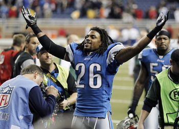 DETROIT, MI - DECEMBER 12:  Louis Delmas #26 of the Detroit Lions leaves the field celebrating a 7-3 victory over the Green Bay Packers on December 12, 2010 at Ford Field in Detroit, Michigan.  (Photo by Gregory Shamus/Getty Images)