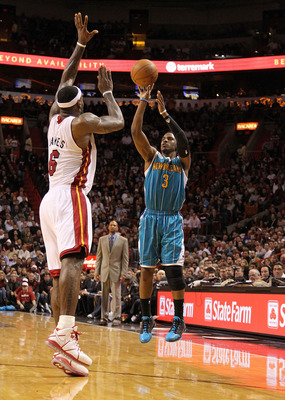 MIAMI, FL - DECEMBER 13:  Chris Paul #3 of the New Orleans Hornets shoots over LeBron James #6 of the Miami Heat during a foul shot during a game at American Airlines Arena on December 13, 2010 in Miami, Florida. NOTE TO USER: User expressly acknowledges