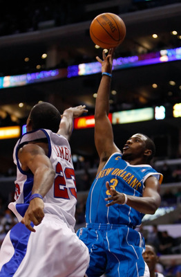 LOS ANGELES, CA - NOVEMBER 09:  Chris Paul #3 of the New Orleans Hornets shoots over Marcus Camby #23 of the Los Angeles Clippers in the first half at Staples Center on November 9, 2009 in Los Angeles, California. NOTE TO USER: User expressly acknowledges