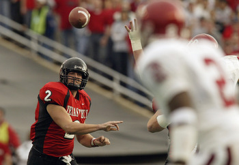 LUBBOCK, TX -NOVEMBER 22:  Quarterback B.J. Symons #2 of the Texas Tech Red Raiders throws a pass during the game against the Oklahoma Sooners at Jones SBC Stadium on November 22, 2003 in Lubbock, Texas.  The Sooners won 56-25.  (Photo by Ronald Martinez/