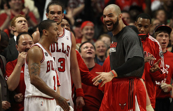 CHICAGO, IL - MAY 15:  (L-R) Derrick Rose #1, Joakim Noah #13 and Carlos Boozer #5 of the Chicago Bulls celebrate late in the fourth quarter against the Miami Heat in Game One of the Eastern Conference Finals during the 2011 NBA Playoffs on May 15, 2011 a