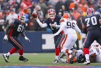 ORCHARD PARK, NY - DECEMBER 12:  Ryan Fitzpatrick #14 of the Buffalo Bills looks to pass with pressure from David Bowens #96 of the Cleveland Browns at Ralph Wilson Stadium on December 12, 2010 in Orchard Park, New York. Buffalo won 13-6.  (Photo by Rick