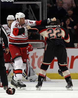 CHICAGO, IL - MARCH 04: Bryan Allen #5 of the Carolina Hurricanes punches Troy Brouwer #22 of the Chicago Blackhawks in the head during a fight in the 3rd period at the United Center on March 4, 2011 in Chicago, Illinois. The Blackhawks defeated the Hurri