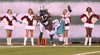 EAST RUTHERFORD, NJ - DECEMBER 12: Braylon Edwards #17 of the New York Jets has his reception broken up by Vontae Davis #21 of the Miami Dolphins at New Meadowlands Stadium on December 12, 2010 in East Rutherford, New Jersey.  (Photo by Nick Laham/Getty I