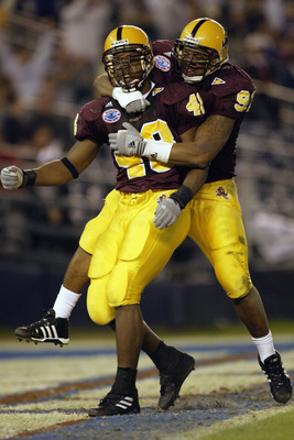SAN DIEGO - DECEMBER 27:  Terrell Suggs #48 and Jimmy Verdon #91 of the Arizona State Sun Devils celebrate during the Pacific Life Holiday Bowl against the Kansas State Wildcats at Qualcomm Stadium on December 27, 2002 in San Diego, California.  The Wildc