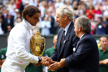 LONDON, ENGLAND - JULY 04:  Rafael Nadal of Spain (L) is presented the Championship trophy by the Duke of Kent (R) and Tim Phillips after winning the Men's Singles Final match against Tomas Berdych of Czech Republic on Day Thirteen of the Wimbledon Lawn T