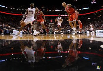 MIAMI, FL - APRIL 06:  Lebron James #6 of the Miami Heat is guarded by Corey Maggette #5 and Drew Gooden #0 of the Milwaukee Bucks during a game at American Airlines Arena on April 6, 2011 in Miami, Florida. NOTE TO USER: User expressly acknowledges and a