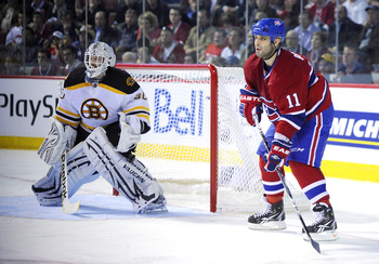 MONTREAL, CANADA - APRIL 26:  Scott Gomez #11 of the Montreal Canadiens waits for pass at the side of the net of Tim Thomas #30 of the Boston Bruins in Game Six of the Eastern Conference Quarterfinals during the 2011 NHL Stanley Cup Playoffs at the Bell C