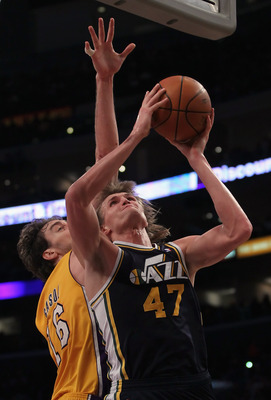 LOS ANGELES, CA - JANUARY 25:  Andrei Kirilenko #47 of the Utah Jazz drives to the basket past Pau Gasol #16 of the Los Angeles Lakers in the first half at Staples Center on January 25, 2011 in Los Angeles, California. NOTE TO USER: User expressly acknowl