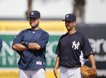 TAMPA, FL - FEBRUARY 20: Robinson Cano #24 Derek Jeter #2 and Jorge Posada #20 of the New York Yankees watch the action during the first full team workout of Spring Training on February 20, 2011 at the George M. Steinbrenner Field in Tampa, Florida.  (Pho
