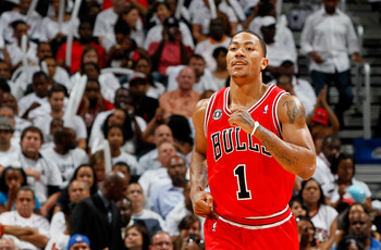 ATLANTA, GA - MAY 12:  Derrick Rose #1 of the Chicago Bulls reacts after scoring a basket against the Atlanta Hawks in Game Six of the Eastern Conference Semifinals in the 2011 NBA Playoffs at Phillips Arena on May 12, 2011 in Atlanta, Georgia.  NOTE TO U