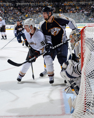 NASHVILLE, TN - APRIL 20:  Jason Blake #33 of the Anaheim Ducks and Kevin Klein #8 of the Nashville Predators fight for position in front of Predator goalie Pekka Rinne #35 in Game Four of the Western Conference Quarterfinals during the 2011 NHL Stanley C