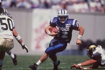 16 Sep 1995:  Quarterback Beau Morgan #12 of the Air Force Falcons looks up field as he scans the defense for an opening while running with the football during a carry in the Falcons 27-20 loss to the Colorado State Rams at Falcon Stadium in Colorado Spri