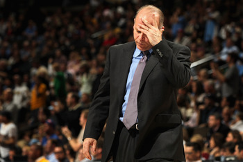 DENVER, CO - MARCH 12:  Head coach John Kuester of the Detroit Pistons reacts during a time out against the Denver Nuggets at the Pepsi Center on March 12, 2011 in Denver, Colorado. The Nuggets defeated the Pistons 131-101.  NOTE TO USER: User expressly a