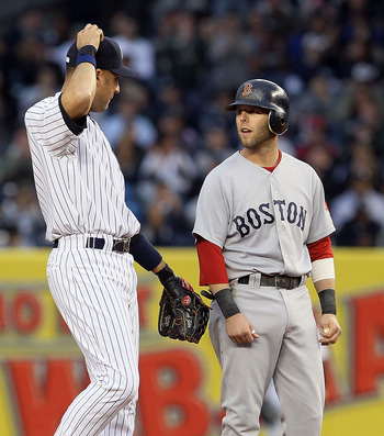 NEW YORK, NY - MAY 14:  Dustin Pedroia #15 of the Boston Red Sox talks to Derek Jeter #2 of the New York Yankees during the first inning on May 14, 2011 at Yankee Stadium in the Bronx borough of New York City.  (Photo by Jim McIsaac/Getty Images)
