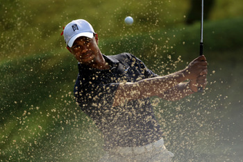 PONTE VEDRA BEACH, FL - MAY 12:  Tiger Woods hits from a bunker on the sixth hole during the first round of THE PLAYERS Championship held at THE PLAYERS Stadium course at TPC Sawgrass on May 12, 2011 in Ponte Vedra Beach, Florida. Woods withdrew after sho