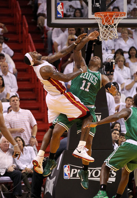 MIAMI, FL - MAY 03:  LeBron James #6 of the Miami Heat is fouled by Glen Davis #11 of the Boston Celtics during Game Two of the Eastern Conference Semifinals of the 2011 NBA Playoffs at American Airlines Arena on May 3, 2011 in Miami, Florida. NOTE TO USE