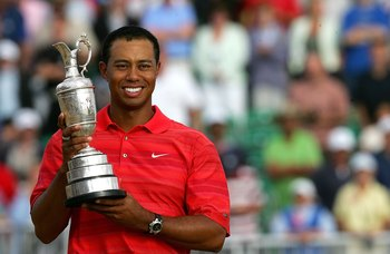 HOYLAKE, UNITED KINGDOM - JULY 23:  Tiger Woods of USA poses with the claret jug following his two shot victory at the end of the final round of The Open Championship at Royal Liverpool Golf Club on July 23, 2006 in Hoylake, England.  (Photo by David Cann