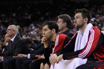 OAKLAND, CA - MARCH 25: Jose Calderon #8 of the Toronto Raptors sits on the bench during their loss to the Golden State Warriors at Oracle Arena on March 25, 2011 in Oakland, California. NOTE TO USER: User expressly acknowledges and agrees that, by downlo