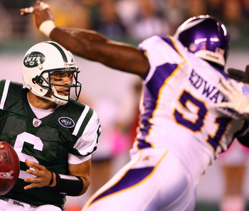 EAST RUTHERFORD, NJ - OCTOBER 11:  Quarterback Mark Sanchez #6 of the New York Jets looks to pass in the first half against Ray Edwards #91 of the Minnesota Vikings at New Meadowlands Stadium on October 11, 2010 in East Rutherford, New Jersey.  (Photo by