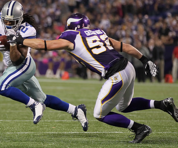 MINNEAPOLIS - OCTOBER 17:  Running back Marion Barber #24 of the Dallas Cowboys is pursued by Chad Greenway #52 of the Minnesota Vikings during the second quarter at Mall of America Field on October 17, 2010 in Minneapolis, Minnesota. The Vikings defeated