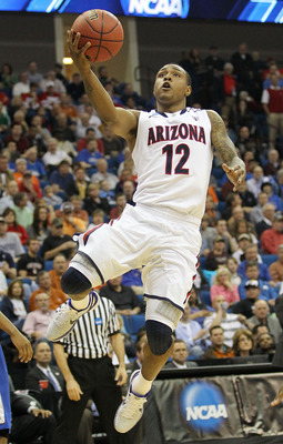 TULSA, OK - MARCH 18:  Lamont Jones #12 of the Arizona Wildcats goes up for a shot against the Memphis Tigers during the second round of the 2011 NCAA men's basketball tournament at BOK Center on March 18, 2011 in Tulsa, Oklahoma.  (Photo by Ronald Martin
