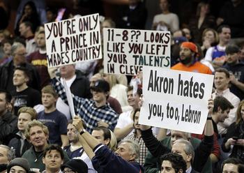 CLEVELAND, OH - DECEMBER 02:  Fans hold up signs prior to the Cleveland Cavaliers playing the Miami Heat at Quicken Loans Arena on December 2, 2010 in Cleveland, Ohio. NOTE TO USER: User expressly acknowledges and agrees that, by downloading and or using
