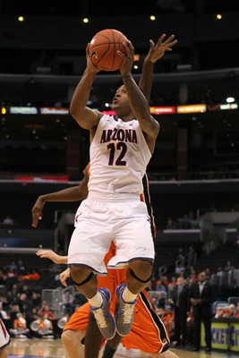 LOS ANGELES, CA - MARCH 10:  Lamont Jones #12 of the Arizona Wildcats goes up for a shot in the second half while taking on the Oregon State Beavers in the quarterfinals of the 2011 Pacific Life Pac-10 Men's Basketball Tournament at Staples Center on Marc