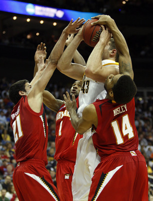 KANSAS CITY, MO - MARCH 19:  Greivis Vasquez #21, Landon Milbourne #1 and Sean Mosley #14 of the Maryland Terrapins defend a shot attempt by Harper Kamp #43 of the California Golden Bears in the first half during the first round of the NCAA Division I Men
