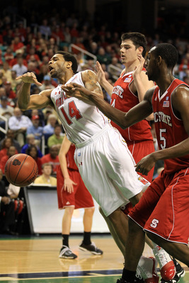 GREENSBORO, NC - MARCH 10:  Sean Mosley #14 of the Maryland Terrapins loses possession of the ball against Jordan Vandenberg #14 and C.J. Leslie #5 of the North Carolina State Wolfpack during the first half of the game in the first round of the 2011 ACC m