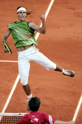 PARIS - JUNE 3:  Rafael Nadal of Spain celebrates winning a point during his semi-final match against Roger Federer of Switzerland during the twelfth day of the French Open at Roland Garros on June 3, 2005 in Paris, France. (Photo by Clive Mason/Getty Ima