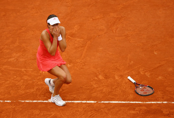 PARIS - JUNE 07:  Ana Ivanovic of Serbia reacts as she clinches victory during the Women's Singles Final match against Dinara Safina of Russia on day fourteen of the French Open at Roland Garros on June 7, 2008 in Paris, France.  (Photo by Julian Finney/G