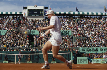 JUN 1991:  JIM COURIER OF THE UNITED STATES PLAYS A BACKHAND RETURN DURING THE MENS SINGLES FINALS AT THE 1991 FRENCH OPEN AT ROLAND GARROS. COURIER DEFEATED ANDRE AGASSI OF THE UNITED STATES TO TAKE THE CHAMPIONSHIP.