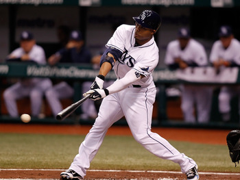 ST. PETERSBURG - SEPTEMBER 27:  Carl Crawford #13 of the Tampa Bay Rays fouls off a pitch against the Baltimore Orioles during the game at Tropicana Field on September 27, 2010 in St. Petersburg, Florida.  (Photo by J. Meric/Getty Images)