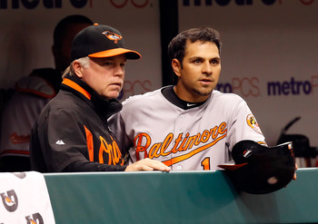 ST. PETERSBURG, FL - MAY 14:  Manager Buck Showalter of the Baltimore Orioles talks with Brian Roberts #1 during the game against the Tampa Bay Rays at Tropicana Field on May 14, 2011 in St. Petersburg, Florida.  (Photo by J. Meric/Getty Images)
