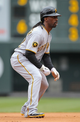 DENVER, CO - MAY 01:  Center fielder Andrew McCutchen #22 of the Pittsburgh Pirates leads off second base against the Colorado Rockies at Coors Field on May 1, 2011 in Denver, Colorado. The Pirates defeated the Rockies 8-4.  (Photo by Doug Pensinger/Getty
