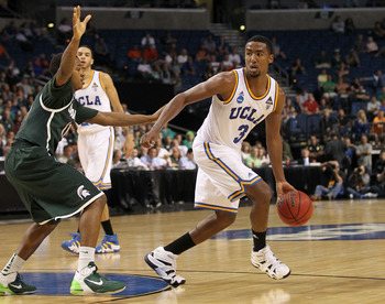 TAMPA, FL - MARCH 17:  Malcolm Lee #3 of the UCLA Bruins looks to pass against the Michigan State Spartans during the second round of the 2011 NCAA men's basketball tournament at St. Pete Times Forum on March 17, 2011 in Tampa, Florida. UCLA won 78-76. (P