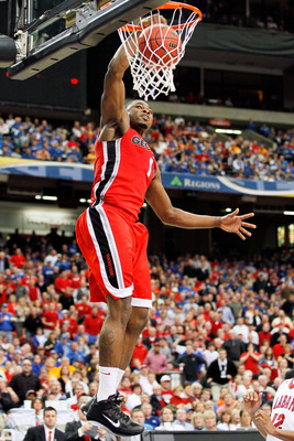 ATLANTA, GA - MARCH 11:  Travis Leslie #1 of the Georgia Bulldogs dunks on the Alabama Crimson Tide during the quarterfinals of the SEC Men's Basketball Tournament at Georgia Dome on March 11, 2011 in Atlanta, Georgia.  (Photo by Kevin C. Cox/Getty Images