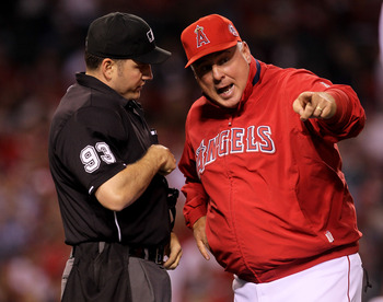 ANAHEIM, CA - MAY 11:  Manager Mike Scioscia of the Los Angeles Angels of Anaheim argues with home plate umpire Dan Bellino during the game with the Chicago White Sox on May 11, 2011 at Angel Stadium in Anaheim, California.  (Photo by Stephen Dunn/Getty I