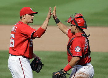 WASHINGTON, DC - MAY 15:  Relief pitcher Cole Kimball #65 of the Washington Nationals and catcher Ivan Rodriguez #7 celebrate after the Nationals defeated the Florida Marlins 8-4  at Nationals Park on May 15, 2011 in Washington, DC.  (Photo by Rob Carr/Ge