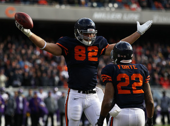 CHICAGO - NOVEMBER 14: Greg Olsen #82 of the Chicago Bears celebrates a touchdown catch with teammate Matt Forte #22 against the Minnesota Vikings at Soldier Field on November 14, 2010 in Chicago, Illinois. (Photo by Jonathan Daniel/Getty Images)