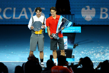 LONDON, ENGLAND - NOVEMBER 28:  Roger Federer (R) of Switzerland poses with the winners trophy and Rafael Nadal of Spain after their men's final match during the ATP World Tour Finals at O2 Arena on November 28, 2010 in London, England.  (Photo by Matthew