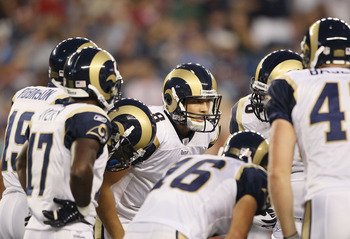 FOXBORO, MA - AUGUST 26:  Sam Bradford #8 of the St. Louis Rams talks in the huddle in the first half against the New England Patriots on August 26, 2010 at Gillette Stadium in Foxboro, Massachusetts.  (Photo by Elsa/Getty Images)