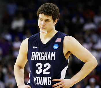 NEW ORLEANS, LA - MARCH 24:  Jimmer Fredette #32 of the Brigham Young Cougars reacts during their 74 to 83 loss to the Florida Gators in the Southeast regional of the 2011 NCAA men's basketball tournament at New Orleans Arena on March 24, 2011 in New Orle