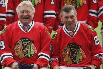 CHICAGO - JULY 22: Former Chicago Blackhawk players Bobby Hull and Stan Mikita look on during the NHL Winter Classic 2009 press conference on July  22, 2008 at Wrigley Field in Chicago, Illinois. (Photo by Jonathan Daniel/Getty Images for the NHL)
