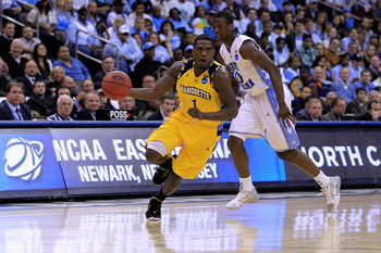 NEWARK, NJ - MARCH 25:  Darius Johnson-Odom #1 of the Marquette Golden Eagles in action against the North Carolina Tar Heels during the east regional semifinal of the 2011 NCAA Men's Basketball Tournament at the Prudential Center on March 25, 2011 in Newa