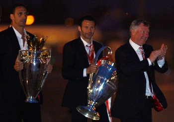 MANCHESTER - MAY 22:  Rio Ferdinand, Ryan Giggs and Alex Ferguson arrive back from Moscow after their win over Chelsea in the Champions League final on May 22, 2008 in Manchester, England.  (Photo by Jeff J Mitchell/Getty Images)